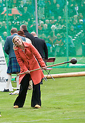 BRAEMAR, UNITED KINGDOM - SEPTEMBER 06: Sky News Royal Correspondant Sarah Hughes learns to throw the Hammer during the Annual Braemar Highland Gathering on September 6, 2008 in Braemar, Scotland. The Braemar Gathering is the most famous of the Highland Games and is known Worldwide. Each year thousands of visitors descend on this small Scottish village on the first Saturday in September to watch one of the more colourful Scottish traditions. The Gathering has a long history and in its modern form it stretches back nearly 200 years.