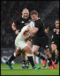November 10, 2018 - London, London, United Kingdom - England face the All Blacks at Twickenham Stadium during the Quilter Internationals 2018. New Zealand Damian McKenzie is tackled by England's defence  during the Quilter Internationals 2018 game at Twickenham  (Credit Image: © Andrew Parsons/i-Images via ZUMA Press)