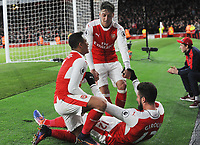 Football - 2016 / 2017 Premier League - Arsenal vs. Bournemouth<br /> <br /> Alexis Sanchez of Arsenal celebrates scoring his second goal in injury time with Olivier Giroud and Mesut Ozil at The Emirates.<br /> <br /> COLORSPORT/ANDREW COWIE