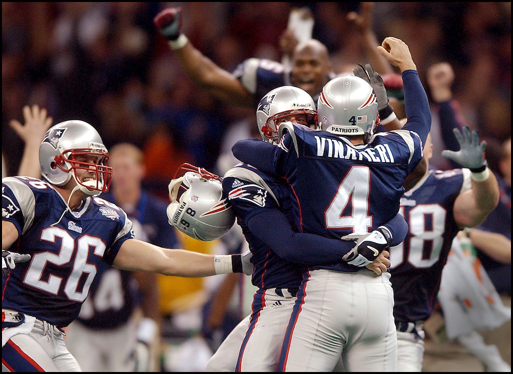 "adfrg ""Untitled"" Super Bowl Patriots vs Rams. Adam Vinitieri jumps into the arms of pats players after kicking the game winning FG."