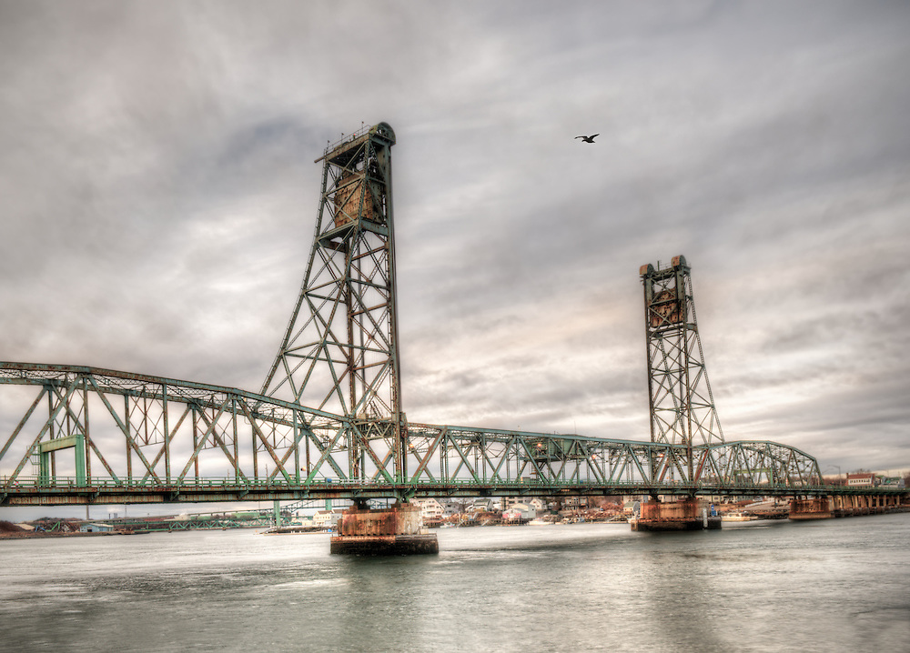 Memorial Bridge over the Piscataqua River rat dusk from the east side in Portsmouth, New Hampshire.