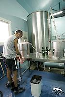 lab at J-P Moueix wine maker and exporter in Libourne, France<br /><br />testing grapes just harvested in various vineyards in Pomerol, near Bordeaux<br /><br />photo Owen Franken