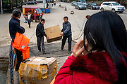 Cargo is loaded onto a ferry in Xishuangbanna prefecture, China.