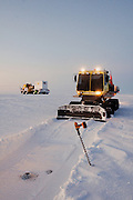 Alaska, North Slope. Profiling a frozen water body, one of the many tenets of ice road construction.