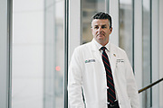 "BIRMINGHAM, AL – MARCH 1, 2018: Trauma surgeon Dr. Jeffery Kerby stands in a corridor at the University of Alabama at Birmingham. Kerby, a former Air Force surgeon, said he will never forget the first time he saw a victim of an assault rifle shooting 16 years ago in the Southern Philippines – the second front in the war on terror. The soldier's entry wound was a tiny hole in his outer thigh, but when he turned the soldier over to view the exit wound, he was surprised to see the man's inner thigh completely blown out. <br /> <br /> According to Kerby, assault style weapons are devastating to the human body, such that a surgeon can now quickly recognize the telltale signs of an AR-15 wound. The high energy bullet creates a blast wave which travels through the body, pushing tissue and organs aside violently. Patients that survive long enough to reach a hospital have little hope of recovering damaged organs. Too often, they bleed to death before even reaching an operating room. <br /> <br /> Despite being long retired from the military, Kerby is seeing AR-15 wounds more frequently at UAB hospital as a result of shootings on the streets of Birmingham. """"These weapons are meant to kill people,"" Kerby said."" ""Assault weapons have no place in civilian hands."" <br /> <br /> Since the Dickey Amendment of 1996, public funding for gun violence research has been prohibited, but Kerby believes there is a way to have a civilized discussion about gun violence research, without threatening second amendment rights. """"The two are not mutually exclusive,"" he said. <br /> <br /> CREDIT: Bob Miller for The New York Times"