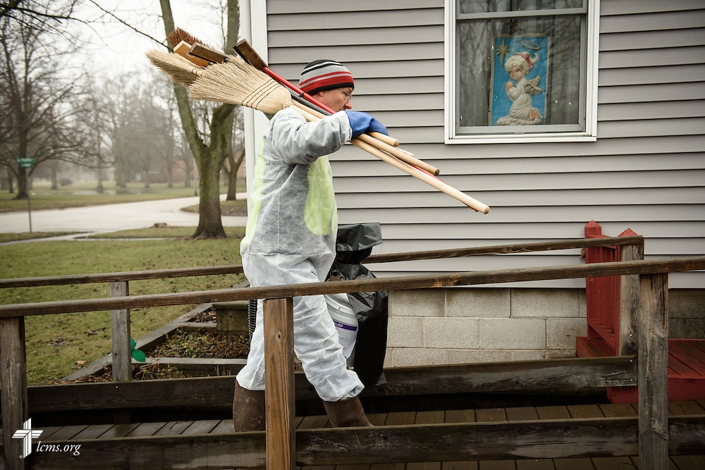 Brent Amidon of Mount Pulaski, Ill., walks into a flood-damaged home during a cleanup volunteer event on Saturday, Jan. 9, 2016, in Watseka. A flood at the end of December ravaged over a 60-block radius of the town. LCMS Communications/Erik M. Lunsford