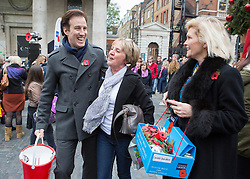 © Licensed to London News Pictures. 07/11/2013.  Strictly Come Dancing stars Anton Du Beke and Fiona Fullerton were out today collecting for the Poppy Appeal in Covent Garden as part of London Poppy Day.  The dance stars joined service personnel to help the charity raise one million pounds in the capital today.  Photo credit: Alison Baskerville/LNP