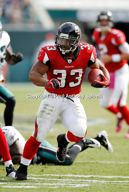 Atlanta Falcons running back Michael Turner (33) runs the ball during the NFL week 6 football game against the Philadelphia Eagles on Sunday, October 17, 2010 in Philadelphia, Pennsylvania. The Eagles won the game 31-17. (©Paul Anthony Spinelli)