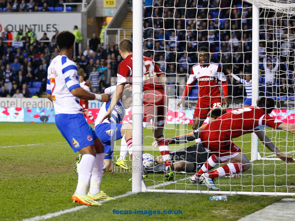 Adam Le Fondre of Reading (C) scores their first goal in a goalmouth scramble during the Sky Bet Championship match at the Madejski Stadium, Reading<br /> Picture by Andrew Tobin/Focus Images Ltd +44 7710 761829<br /> 22/04/2014