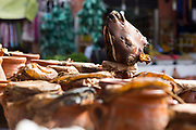 Traditional 'tangia Marrakechia' local Marrakesh cuisine dish, Marrakech, Morocco, 2016–04-21.<br /><br />Tangia is the name of both the stew and the ceramic pot it's cooked in. The dish involves chunks of beef with all the fat, bone marrow and trimmings which are marinated and slow cooked in a vase like ceramic pot with chopped preserved lemon, cilantro, parsley, garlic and onions. <br /><br />Traditionally, the pots are taken to the furnace ovens inside the Medina of Marrakesh which heats water for the local 'hammans' (communal baths) and left to slow cook at a low temperature for long durations of time, sometimes for as long as 24hrs. <br /><br />It is considered a specialty of Marrakesh where there are many street food stands still using this traditional method inside the old Medina, although it is also replicated in restaurants. <br /><br />Finding a traditional stand popular among locals which uses the authentic method of cooking will rival any other beef dish on offer in Morocco. <br /><br />The dish is joked to known as being a very 'male' dish in Morocco because it's easy to prepare and the task of it's preparation is 'trusted' to men.<br /><br />It's also known as a 'working mans lunch' in Marrakesh because of the large queues of young men on their lunch break often seen besides the stands in the old Medina in the past.