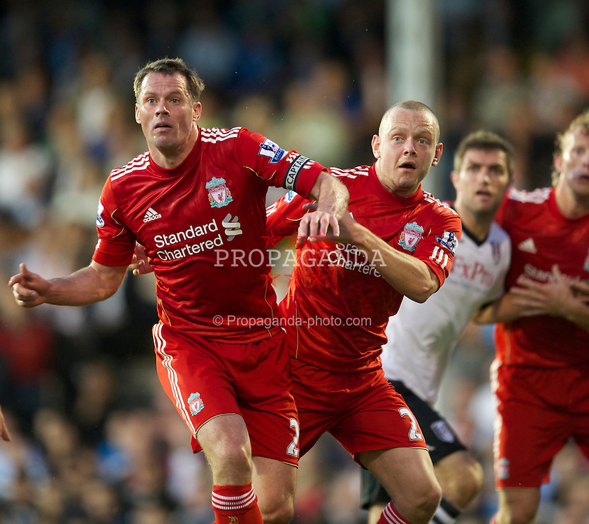 LONDON, ENGLAND - Monday, May 9, 2011: Liverpool's Jamie Carragher and Jay Spearing in action against Fulham during the Premiership match at Craven Cottage. (Photo by David Rawcliffe/Propaganda)