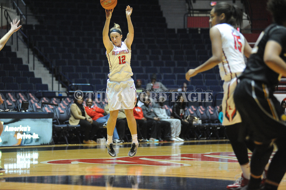 "Ole Miss Lady Rebels guard Gracie Frizzell (12) makes a three pointer vs. Southern Mississippi at the C.M. ""Tad"" Smith Coliseum in Oxford, Miss. on Thursday, December 18, 2014. (AP Photo/Oxford Eagle, Bruce Newman)"