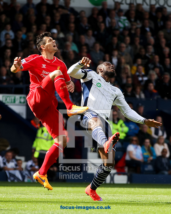 Victor Anichebe (right) of West Bromwich Albion and Dejan Lovren (left) of Liverpool collide with each other during the Barclays Premier League match at The Hawthorns, West Bromwich<br /> Picture by Tom Smith/Focus Images Ltd 07545141164<br /> 25/04/2015