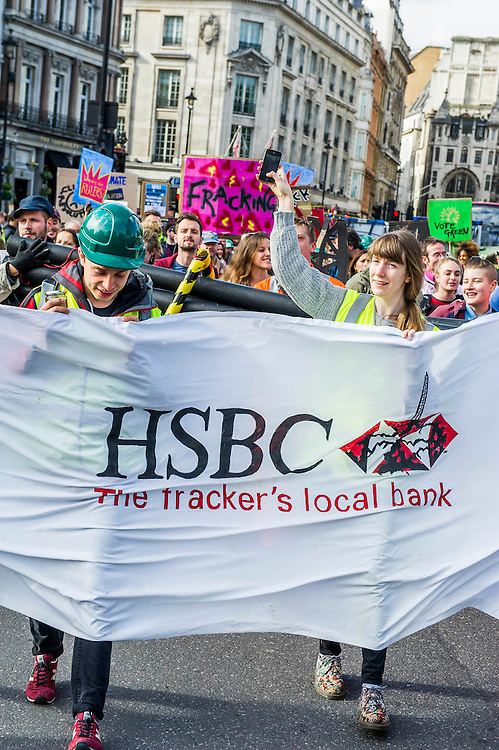 Anti-Fracking protesters target HSBC in global day of action. Mock Drill Rig, 'fracked water', hazard tape and speakers from affected communities turn two Central London HSBCs are turned into 'live fracking sites' in protest about funding to fracking. 'Global Frackdown' day of action sees 100s of actions against fracking in over 30 countries. Regent Street, London. 11 Oct 2014.Guy Bell, 07771 786236, guy@gbphotos.com