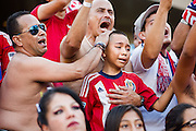 Harat Espinoza, left, and Carlos Barraza, comfort a young fan as they all shed tears cheering with the Union Ultras after the final game of the Chivas USA franchise had come to an end at the StubHub Center in Carson, Calif., on Oct. 26, 2014. Chivas USA defeated the San Jose Earthquakes 1-0.