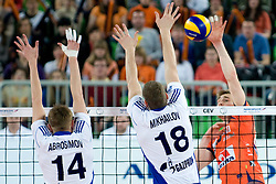Vid Jakopin of ACH Volley vs Maxim Mikhailov and Alexander Abrosimov of Zenit Kazan during volleyball match between ACH Volley (SLO) and Zenit Kazan (RUS) in Playoffs 12 Round of 2011 CEV Champions League, on February 2, 2011 in Arena Stozice, Ljubljana, Slovenia. (Photo By Matic Klansek Velej / Sportida.com)