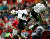 Photo. Chris Ratcliffe<br />Charlton v Fulham. FA Premiership. 11/05/2003<br />Louis Saha is high kicked by Dean Kiely in the incident which saw the Charlton keeper sent off.