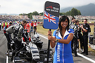 A1 Team New Zealand grid girl and pit crew prior to the start of the A1 GP Sprint Race, Taupo, New Zealand, Sunday 25 January 2009. Photo: Andrew Cornaga/PHOTOSPORT