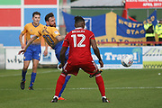 Mansfield Town's Paul Anderson flicks the ball past Bobby Olejnik of Accrington Stanley during the EFL Sky Bet League 2 match between Accrington Stanley and Mansfield Town at the Fraser Eagle Stadium, Accrington, England on 19 August 2017. Photo by John Potts.