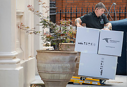 © Licensed to London News Pictures. 31/07/2018. London, UK. Removals boxes are wheeled out of the official residence of the Foreign Secretary at Carlton Gardens in central London where former Foreign Secretary Boris Johnson has been living since his resignation. Photo credit: Rob Pinney/LNP
