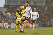 Fulham defender Tim Ream (13) on the ball during the EFL Sky Bet Championship match between Fulham and Burton Albion at Craven Cottage, London, England on 20 January 2018. Photo by Richard Holmes.