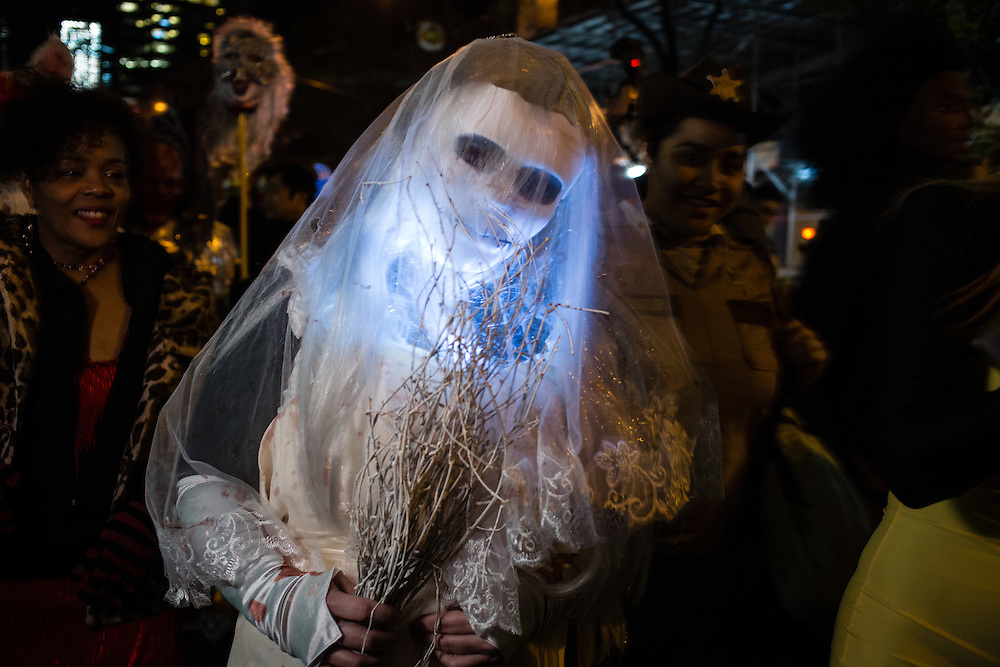 New York, NY - 31 October 2016. A woman veiled as if a bride, but with a death mask painted on her face,  in the Greenwich Village Halloween Parade.