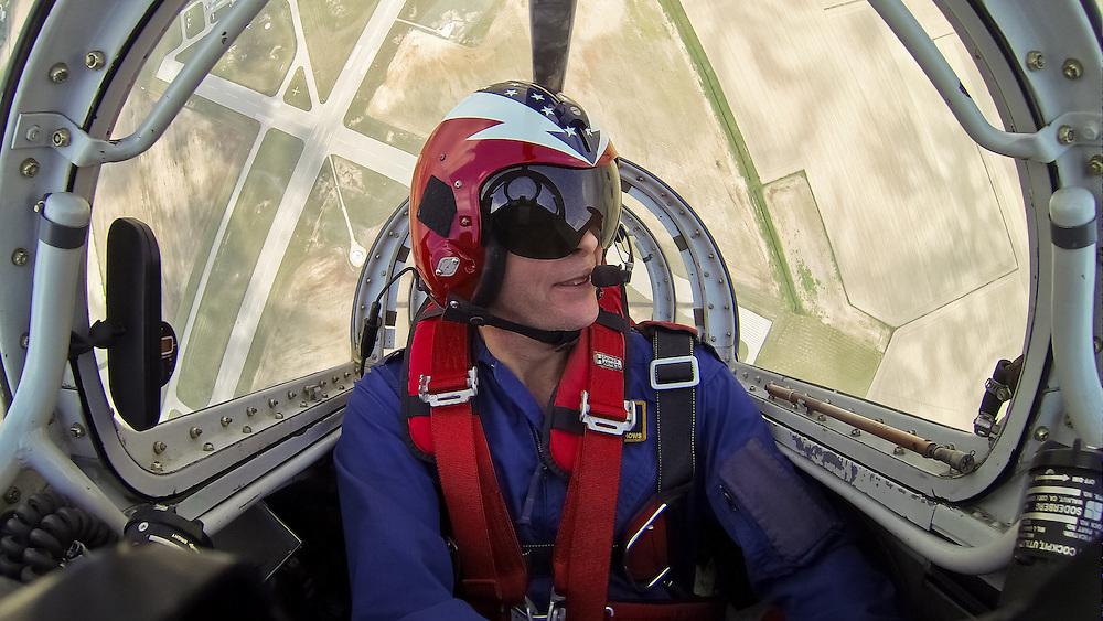Curt Arnspiger performs in &quot;Screaming Arrow,&quot; a Casa Saeta jet, at the Kokomo air show 2013.<br /> <br /> Photo by Matt Cashore