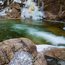 Icicles and the pool below Sabbaday Falls in New Hampshire's White Mountains.