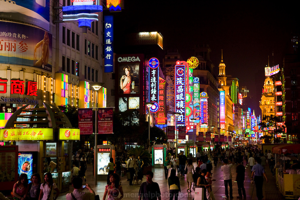 Shoppers and tourists mingle on the busy Nanjing road in Shanghai, China.