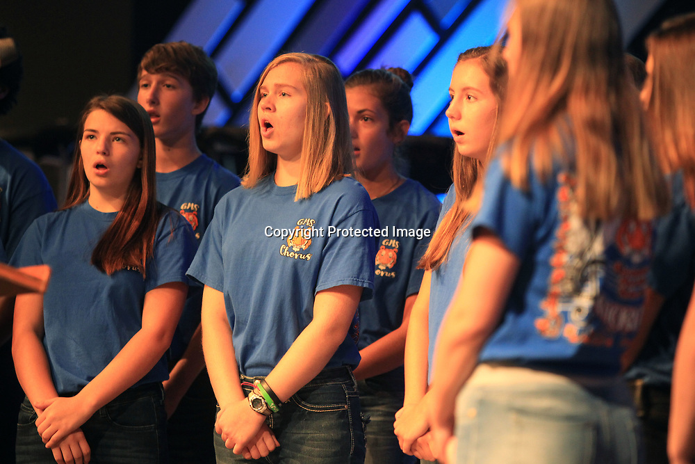 Members of the Guntown Middle School Choir perform the National Anthem to start off the Lee County Schools Back-to-School Convocation Tuesday morning at the Orchard.