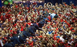 Fans supporting Ole Miss and TCU gather for FanFest in the Georgia World Congress Center before their SEC vs. Big 12 football game on December 31, 2014. David Tulis / Abell Images for the Chick-fil-A Bowl