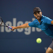 August 21, 2014, New Haven, CT:<br /> James Blake hits a forehand during the Men's Legends Event on day seven of the 2014 Connecticut Open at the Yale University Tennis Center in New Haven, Connecticut Thursday, August 21, 2014.<br /> (Photo by Billie Weiss/Connecticut Open)