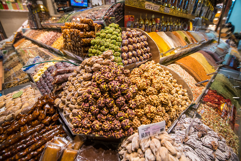 Corner of a market stall displays an assortment of sweets, spices and other goods available for purchase at Istanbul Spice bazaar in Turkey