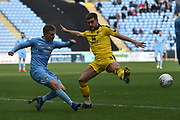 Coventry City midfielder (on loan from Derby County Luke Thomas (23) gets in a cross under pressure from Oxford United defender 9on loan from Everton) Luke Garbutt (3) during the EFL Sky Bet League 1 match between Coventry City and Oxford United at the Ricoh Arena, Coventry, England on 23 March 2019.