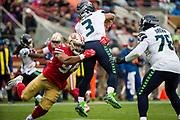 San Francisco 49ers defensive end Solomon Thomas (94) hits Seattle Seahawks quarterback Russell Wilson (3) at Levi's Stadium in Santa Clara, Calif., on November 26, 2017. (Stan Olszewski/Special to S.F. Examiner)