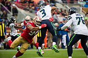 San Francisco 49ers defensive end Solomon Thomas (94) hits Seattle Seahawks quarterback Russell Wilson (3) at Levi's Stadium in Santa Clara, Calif., on November 26, 2017. (Stan Olszewski/Special to S.F. Examiner)