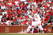 29 June 2010: Dirt and chalk fly as St. Louis Cardinals shortstop Brendan Ryan (13) hits a hard ground ball for a base hit during the third inning against the Arizona Diamondbacks at Busch Stadium in St. Louis, Missouri. .