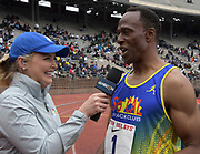Apr 27, 2018; Philadelphia, PA, USA; Willie Gault (right) is interviewed by NBCSN broadcaster Carolyn Manno after winning the Masters age 55 and over 100m in 11.84 during the 124th Penn Relays at Franklin Field.