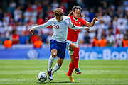 England midfielder Dele Alli (Tottenham) tussles with Switzerland  defender Kevin Mbabu (2) during the UEFA Nations League 3rd place play-off match between Switzerland and England at Estadio D. Afonso Henriques, Guimaraes, Portugal on 9 June 2019.
