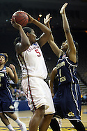 24 MARCH 2009: Oklahoma forward/center Ashley Paris (5) tries to pass the ball over Georgia Tech guard Jacqua Williams (1) during an NCAA Women's Tournament basketball game Tuesday, March 24, 2009, at Carver-Hawkeye Arena in Iowa City, Iowa. Oklahoma defeated Georgia Tech 69-50.