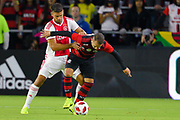 Flamengo midfielder Everton Ribeiro (7) and Ajax defender Lisandro Magallan (16) fight for a ball during a Florida Cup match at Orlando City Stadium on Jan. 10, 2019 in Orlando, Florida. <br /> Flamengo won in penalties 4-3.<br /> <br /> ©2019 Scott A. Miller