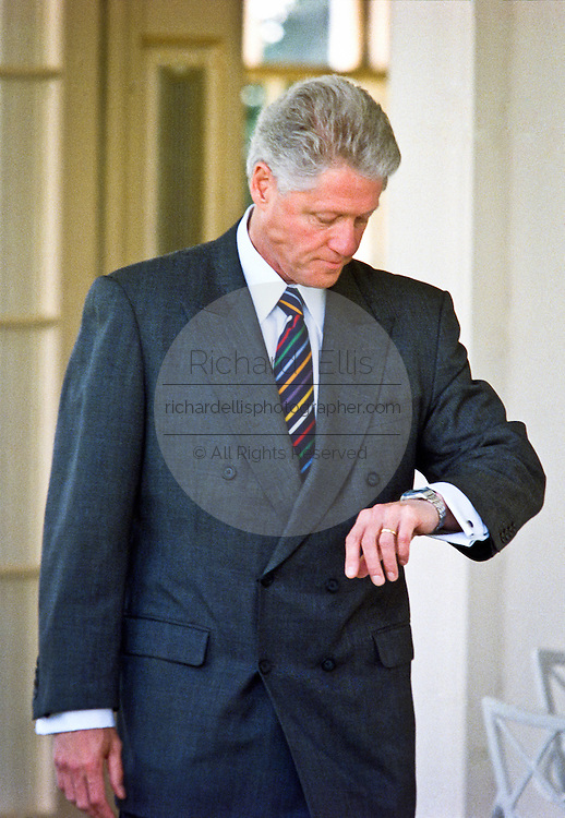 US President Bill Clinton walks from the Oval Office to make a statement on the crisis in Kosovo in the Rose Garden of the White House April 13, 1999 in Washington, DC. Clinton stated that the NATO bombing would cease when Yugoslavia withdraws their troops from Kosovo and allows the return of refugees.
