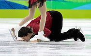 China's Jian Tong kisses the ice after performing his routine with partner Qing Pang in the Figure Skating Pairs Free program at the 2010 Winter Olympics at Pacific Coliseum in Vancouver, Canada on February 15, 2010. The pair won the silver medal in the competition.  (UPI)