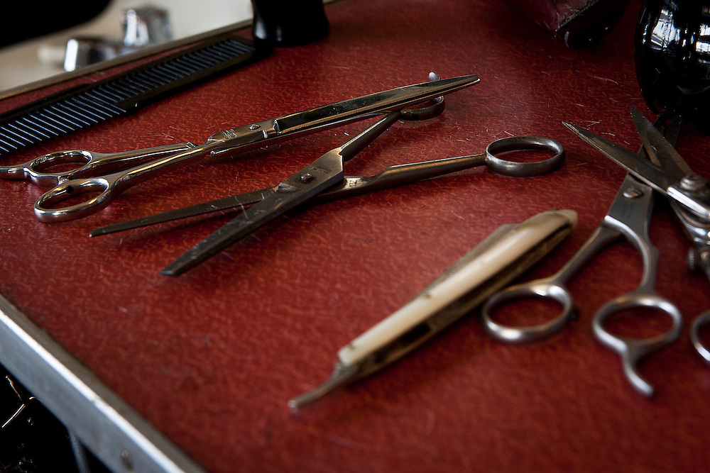 A row of barber's scissors at Clyde Ashcroft's barbershop at 3609 S. State, Friday, Dec. 28, 2012.
