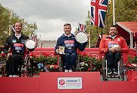 The presentations for the elite Wheelchair Men's Race. Left to right Marcel Hug SUI, David Weir GBR and Kurt Fearnley AUS. The Virgin Money London Marathon, 23rd April 2017.<br /> <br /> Photo: Ben Queenborough for Virgin Money London Marathon<br /> <br /> For further information: media@londonmarathonevents.co.uk