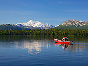 Alaska, Canoeing Byers Lake with a summer scenic view of Mt. McKinley, Denali State Park.