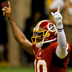 September 9, 2012; New Orleans, LA, USA; Washington Redskins quarterback Robert Griffin III (10) celebrates after a touchdown pass during the first quarter of a game against the New Orleans Saints at the Mercedes-Benz Superdome.  The Redskins defeated the Saints 40-32.  Mandatory Credit: Derick E. Hingle-US PRESSWIRE