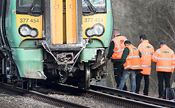 © Licensed to London News Pictures. 17/02/2018. Horsham, UK. Railway workers inspect the damage to a train near a level crossing where two people have been killed near the village of Barns Green after it hit a car. Photo credit: Peter Macdiarmid/LNP