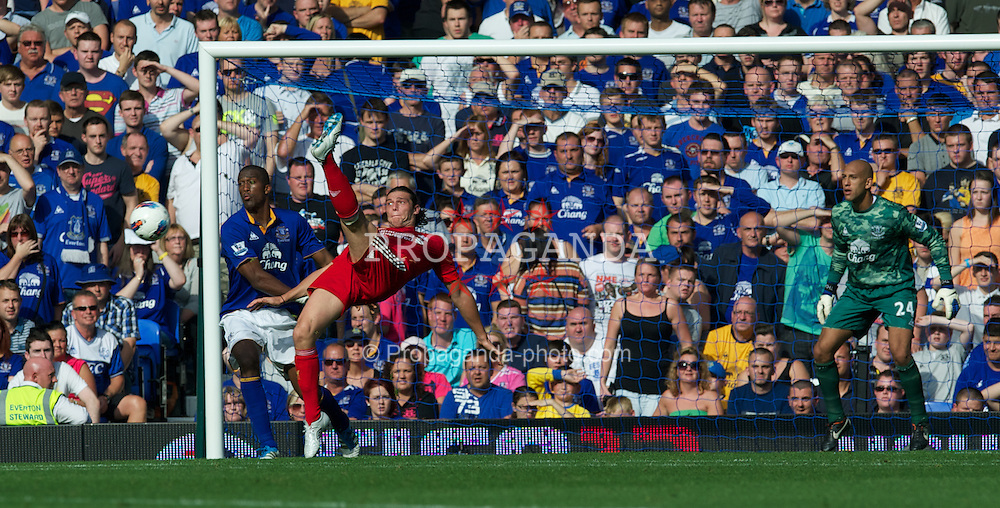LIVERPOOL, ENGLAND - Saturday, October 1, 2011: Liverpool's Andy Carroll in action against Everton during the Premiership match at Goodison Park. (Pic by David Rawcliffe/Propaganda)