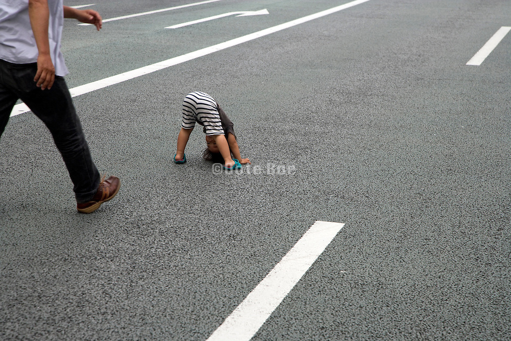 father and child on a public road